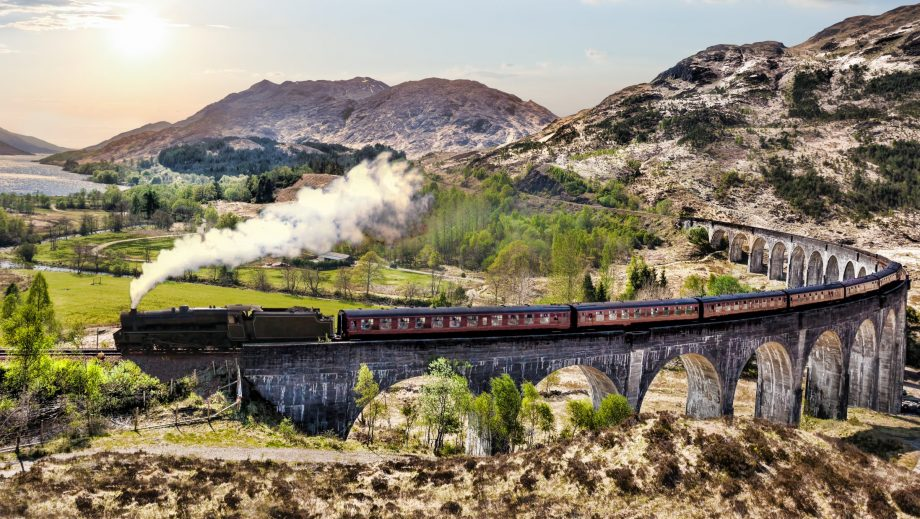 Great train journeys: The Jacobite steam train travels over the Glenfinnan Railway Viaduct in Scotland